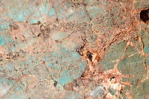 A green-turquoise granite with white veins.
