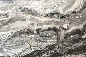 A dark grey marble with light caramel streaks.