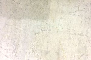 A medium grained, white and cream granite.