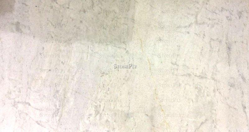 A Medium Grained White And Cream Granite