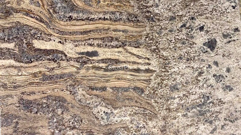 A brown granite with a blue-grey background and veins.