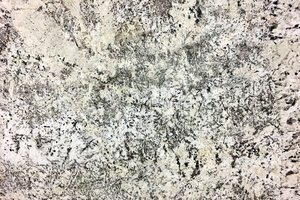 A creme granite with flecks of auburn and medium crystal grains.