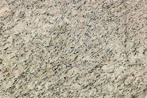 A beige granite with yellow variations and flowing grains of brown and black