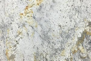 A white granite with grey variations and silver and gold veining