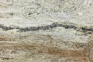 A creme sandy granite with mocha and grey veining