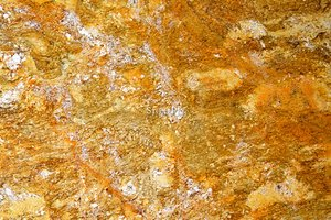 A brown granite with a speckled pattern.