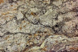 A beige and yellow granite with darker veins.