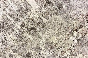 A cream and grey granite with pink and brownish spots.