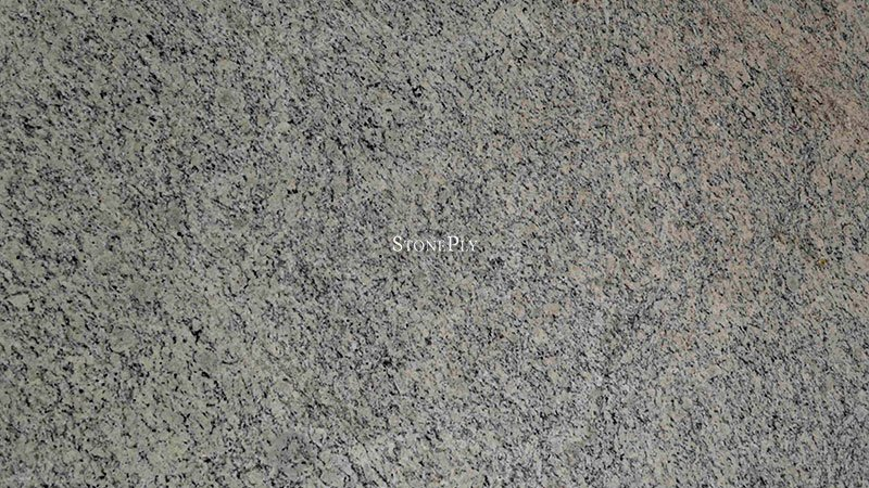 A granite with a mix of cream, white and grey colors.