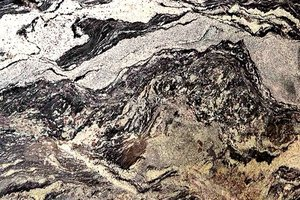 A beige granite with shades of black and white.