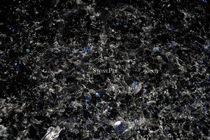 A medium-grained, black and dark blue granite.