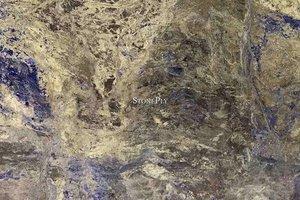 A beige active granite with large blue crystal veins and dark brown veins.