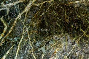 A dark green granite with brown and black veins.