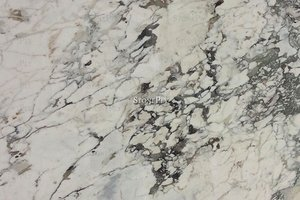 A fine grained, white marble with veins.