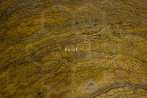 A brown granite with gold and dark grey veins.
