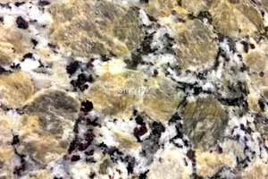 A beige granite with white and black colors in a speckled pattern.