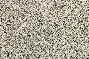 A beige granite with black and brown flecks