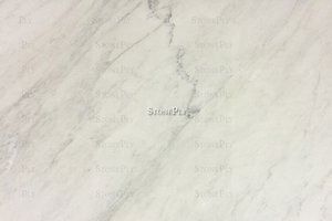 A grey and white marble with veins.