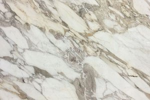 A fine grained, white and grey marble with veins.
