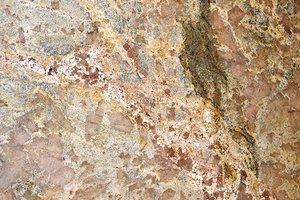 A brown granite with beige and red colors.