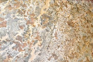 A brown granite with a veined texture.