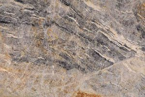A grey and blue granite with veins.