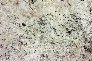 A light cream granite with black speckles and grey veins.
