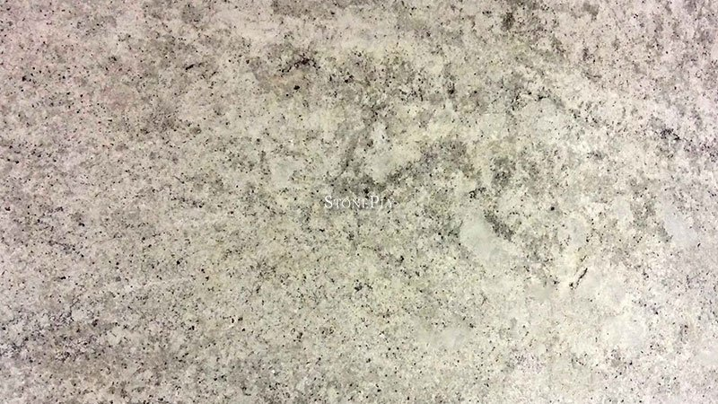 A light grey granite with silver and black flecks.
