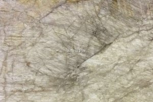 A cream granite with veins.