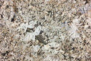 A creme  granite with grey, gold and black.