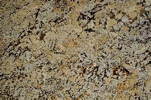 A beige and cream granite with some grey and black.