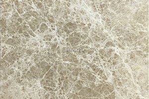 A brown and beige marble with white cross-veining