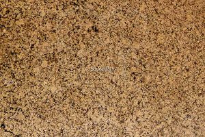 A medium grained, gold-yellow granite.