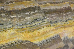 A multicolored marble with a primarily gold color.