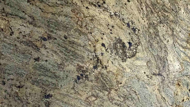 A yellow-gold and grey granite with a veined burgundy texture.