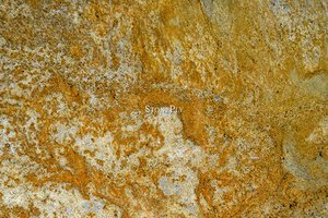 A medium grained, yellow granite that may have some pink.