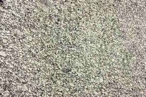 A grey and black granite with a speckled pattern.