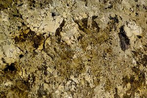 A cream and gold granite with a coarse grained texture.
