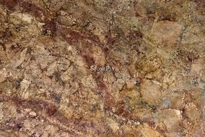 A red and brown granite with a earthly pattern.