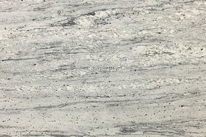 A white granite with grey veining and red dots