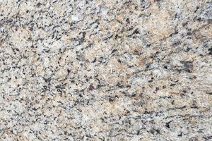A white granite with yellow variation and black veining