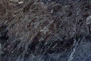 A grey-black granite with lighter veins.