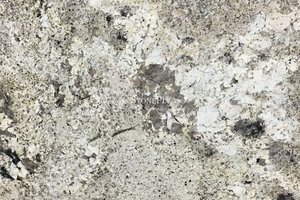A beige granite with white variations and tan, grey and brown veining.