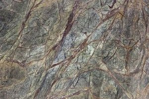 A light and dark green marble with brown and beige veins.