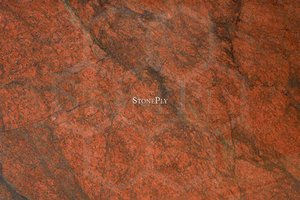 A red-brown granite with a medium texture.