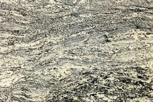 A beige granite with grey and black veining.