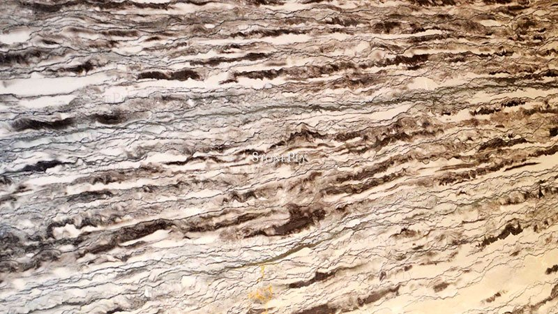 A grey and green granite with a speckled patterns.