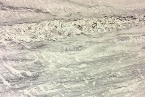 A white granite with low variation.