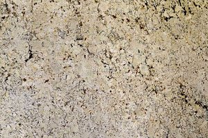 A white granite with brown flakes.