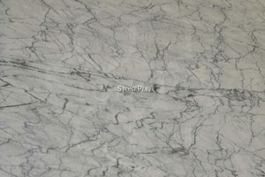 A fine grained, white marble with a dark vein pattern.